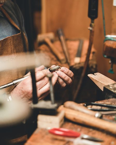 Roger works on a piece of jewellery for his Hackney shop.