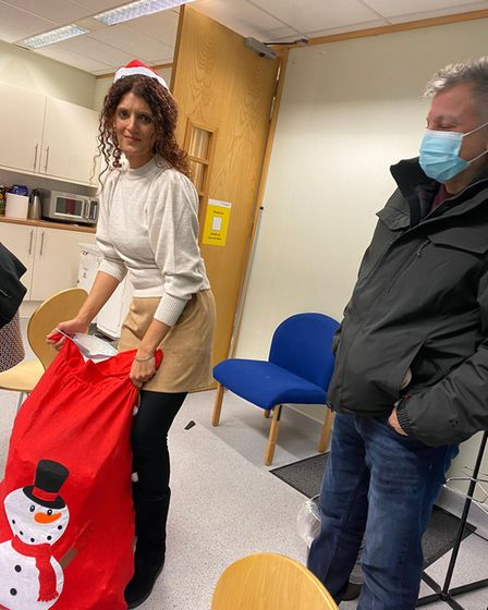 Jas dropping off the bag of chocolates to King George and queens hospitals charity