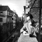 French writer Albert Camus smoking cigarette on balcony outside his publishing firm office. (Photo