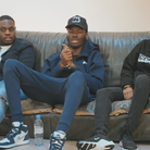 Three members of Hackney Account sit on a couch for interviews at an online launch of their report on policing in Hackney