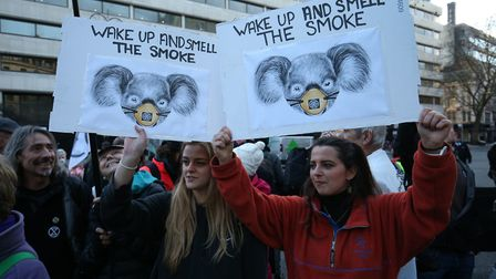 Climate change protesters block the traffic outside the Australian Embassy in London. Photograph: Jo