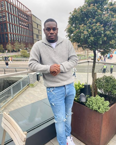 Former Hackney B6 College student, Hackney Account campaigns manager and advocate Emmanuel Onapa leaning on a railing in...