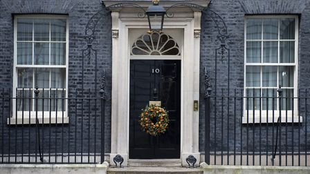 A Christmas wreath is displayed on the door of 10 Downing Street in London after the election result