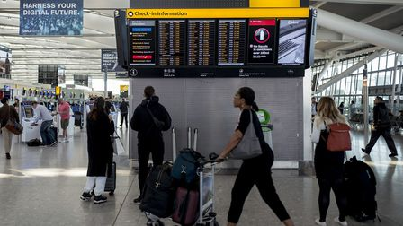 Passengers arrive at Heathrow Airport's Terminal 5 in west London, on September 13, 2019. - British