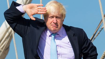 Boris Johnson salutes from the deck of the tall ship Tenacious, which is moored at Woolwich, in east