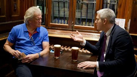 Stephen Barclay speaks to Wetherspoon chairman Tim Martin in a pub. Photograph: Stephen Barclay/Twit