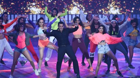 Bollywood actor Salman Khan (C) performs on stage during the 20th International Indian Film Academy