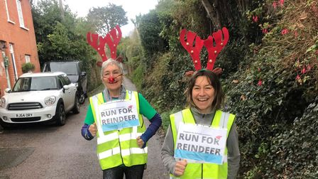 Sharon Howe and Sue Nicholson donning reindeer antlers and hi-vis vests for a reindeer run