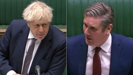 Boris Johnson (L) and Keir Starmer during Prime Minister's Questions
