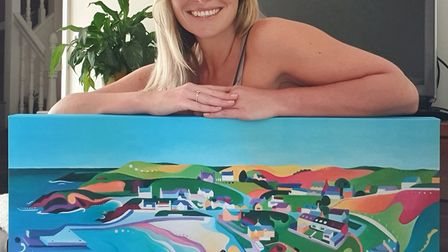 Artist Amy Pettingill with one of her landscapes