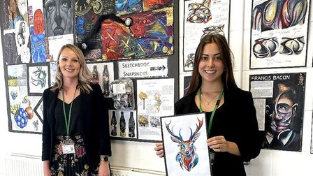 Stanborough teacher Amie Barnard, left, and Izzy Wilkins, right, holding art by her godmother Amy Pe