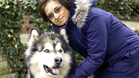 Dr Daksha Trivedi with her neighbour's dog. Picture Jo Brown