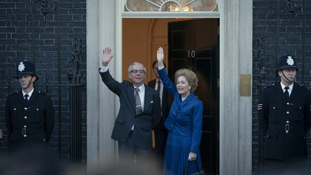 Stephen Boxer as Dennis Thatcher and Gillian Anderson as Margaret Thatcher on the steps of 10 Downin