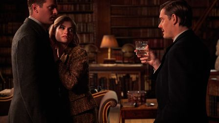 Armie Hammer as Maxim de Winter, Lily James as Mrs de Winter, and Sam Riley as Jack Favell in Rebecc
