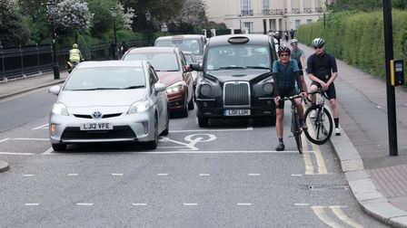 Traffic and cyclists coming out of Regent's Park outer circle. Picture: Adam Butler
