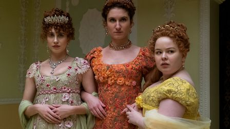 Harriet Cains as Phillipa Featherington, Bessie Carter as Prudence Featherington and Nicola Coughlan