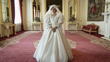 Emma Corrin as Princess Diana in her wedding dress in season four of The Crown. Picture: Des Willie/