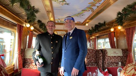 Train manager Paul Heathcote and team memberGraham Smith on board the festive Northern Belle Picture: Ella Wilkinson