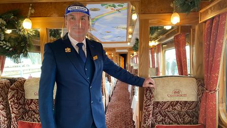 Train manager Paul Heathcote onboard the festive Northern Belle train, which departed from Norwich Station on Wednesday...
