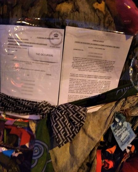 A picture of The Happy Man Tree injunction posted to the tree.