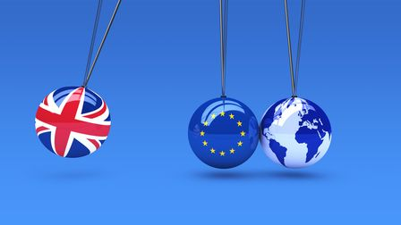 Brexit global business consequences concept with Union Jack, EU flag on balls and world map globe 3D