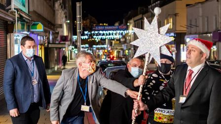The Torquay Christmas lights switch on with [ from the left): Lee Thomas (Chairman, Torbay Hospital