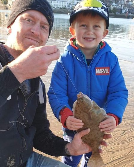 Gareth and Reef Dellar with a flounder