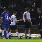 Ref Jacob Miles shows Torquay United player Asa Hall a red card during the English National League game between Kings Lynn...