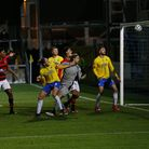 Asa Hall, Captain of Torquay United challenges for the aerial ball with Taye Ashby-Hammond, goalkeep
