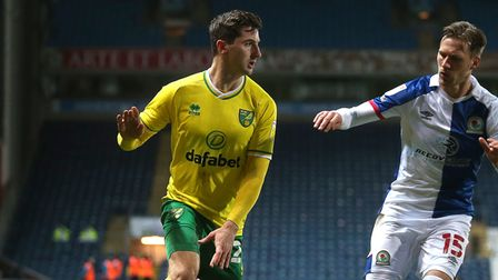 Kenny McLean of Norwich and Barry Douglas of Blackburn Rovers in action during the Sky Bet Champions