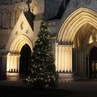 A Christmas tree and the West End porch lights of St Albans Cathedral