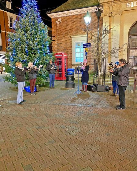 Sidmouth Town Band played in the town centre during the late night shopping event. Picture: Vince Pa