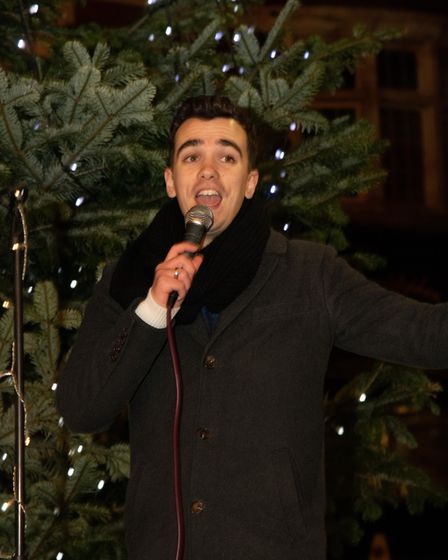 Cameron Lemmer sings in Market Place during Sidmouth Late Night Shopping Picture: Alex Walton
