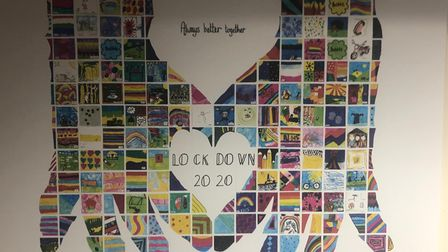 A mosaic artwork created by squares made from children's artwork based on their lockdown experience and formed into a pair...