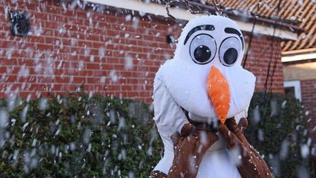 Olaf, the Wensum Wonderland mascot, enjoying the snow machine. Picture: Danielle Booden
