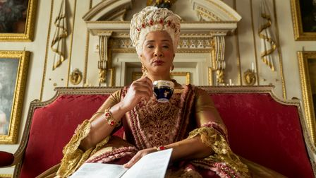 Queen Charlotte drinking from a cup in Bridgerton