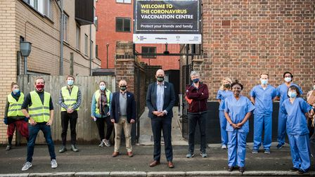 Hackney's mayor Phil Glanville stands with local volunteers and NHS staff outside Hackney's first coronavirus vaccination...