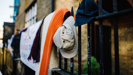 Hats and scarves on a rail in Exmouth Market