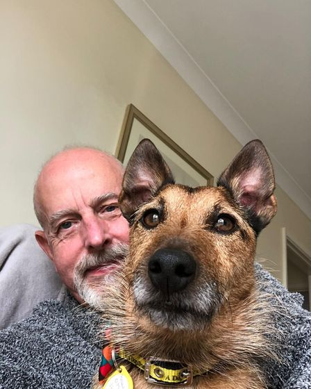 Dogs Trust rescue dog Cadbury with new owner Stephen WIllmott.