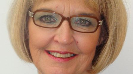 Marilyn Hawes, founder of Freedom from Abuse, smiling and wearing glasses