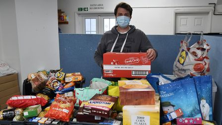 Sam Porter, Operations Manager for Lowestoft Foodbank, with the donations received from the college