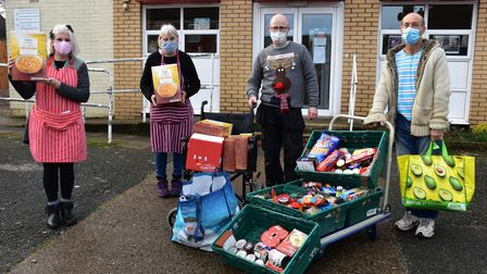 Volunteers from the Great Yarmouth Foodbank with the donations of food from East Coast College.