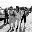 Portrait of Swedish Pop group ABBA as they pose, dockside, in Gamla Stan (Old Town), Stockholm
