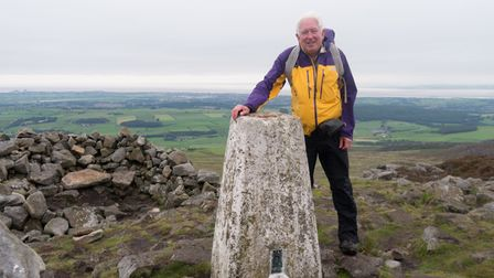Our man at the summit of Clougha Pike.
