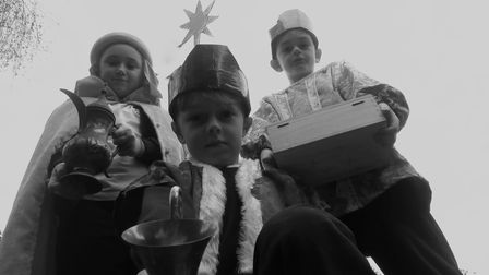 Three boys as the kings in the nativity play