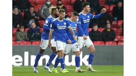 Cardiff City's Kieffer Moore (right) scores his side's first goal of the game with team-mates during
