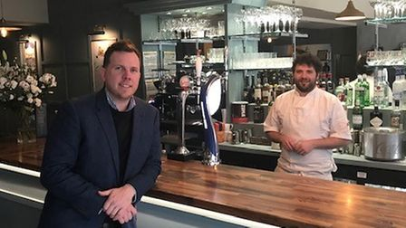 James Sanders from Charles Darrow, left,with business owner and head chefOliver Williamson in the new restaurant Ollies