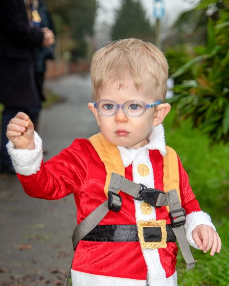Ottery Rotary Club Santa Run. Reggie Stewart, aged two, supporting the racers at the start