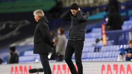 Arsenal manager Mikel Arteta looks dejected at Goodison Park