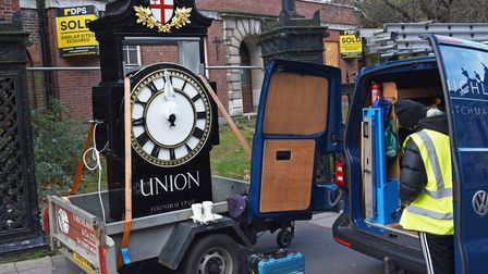 The restored Norwich Union clock ready to be put back up on Surrey Street in Norwich.
